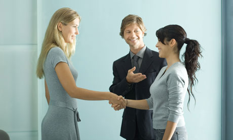 Business-man-introducing-two-women